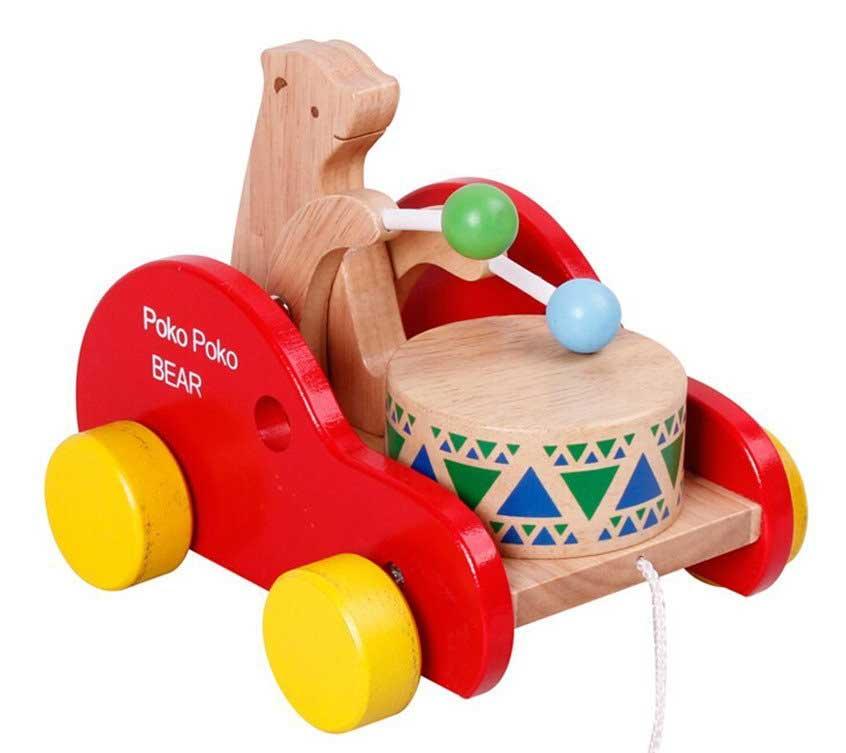 giocattolo-in-legno-con-orsetto-e-tamburo